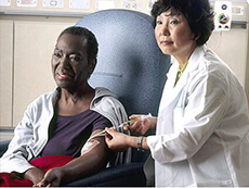 Doctor administering chemotherapy